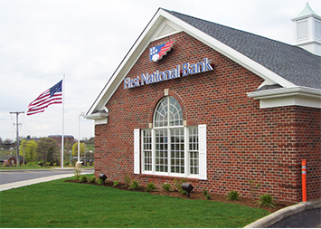 Storefront photo of First National Bank branch located at 303 S Salem St in Apex, NC.